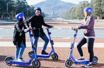 Three people on e-scooters